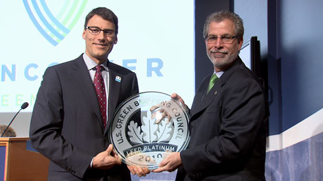 Mayor Gregor receiving the LEED Platinum plaque for the 2010 Vancouver Olympic Village, via CTV