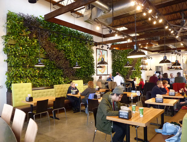 Green Walls Extend A Welcome To Restaurant S Guests By Amber Ponce And David Aquilina