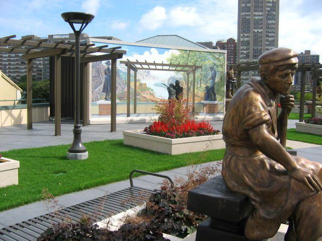 Man at Work Sculpture Garden at the Grohmann Museum Featured Image